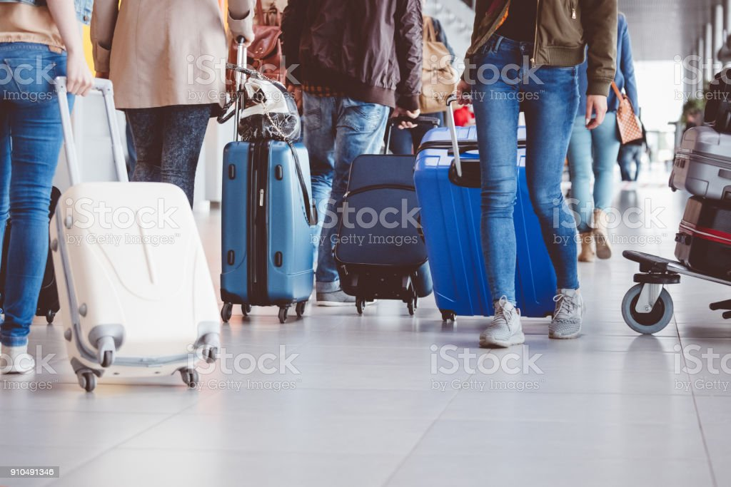 Group of people walking with suitcase at airport terminal stock photo