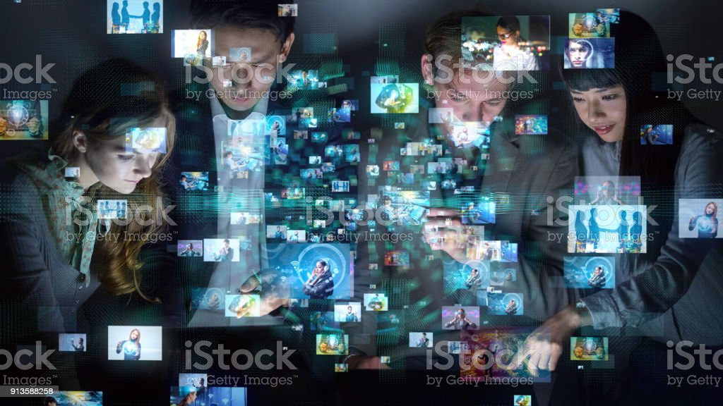Group of people watching many pictures. stock photo