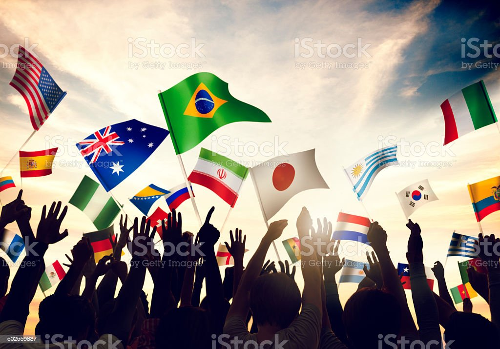 Group of People Waving Flags stock photo