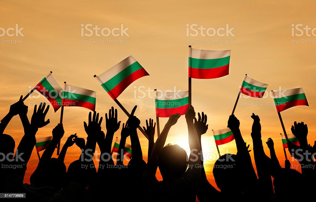 Group of People Waving the Flag of Bulgaria stock photo