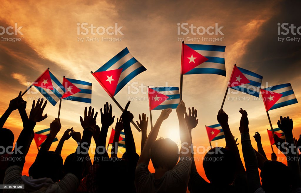 Group of People Waving the Flag of Cuba stock photo