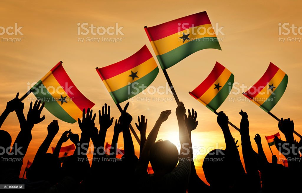 Group of People Waving the Flag of Ghana stock photo