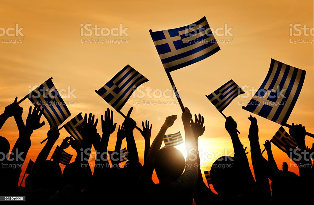 Group of People Waving the Flag of Greece stock photo