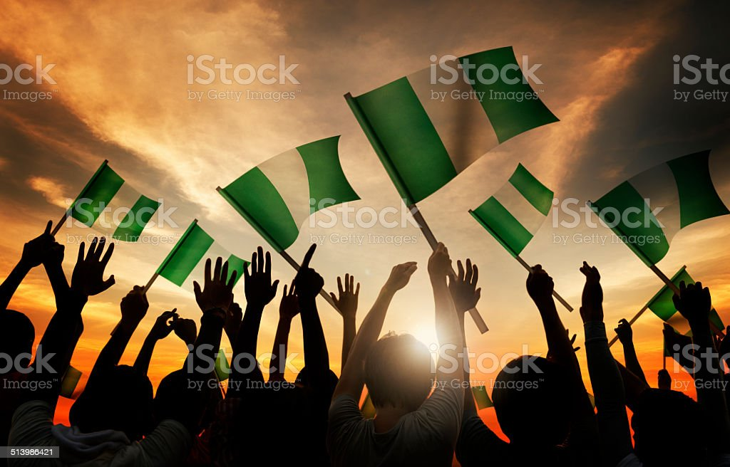 Group of People Waving the Flag of Nigeria stock photo