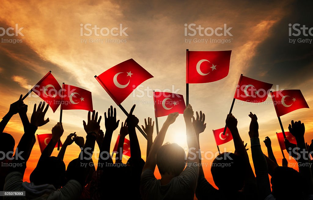 Group of People Waving the Flag of Turkey stock photo