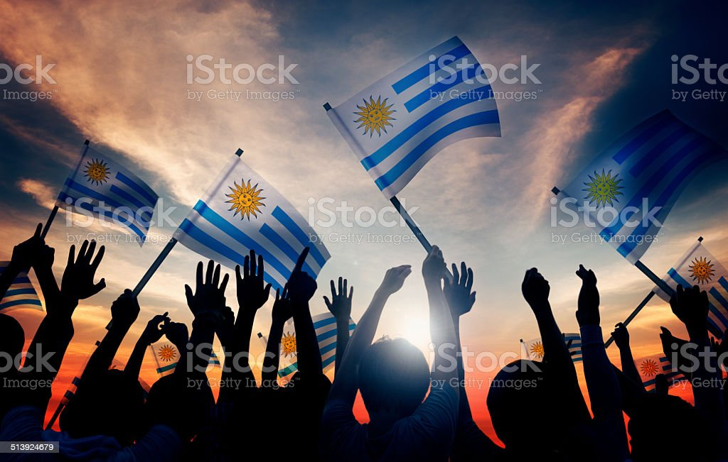 Group of People Waving the Uruguayan flag. stock photo