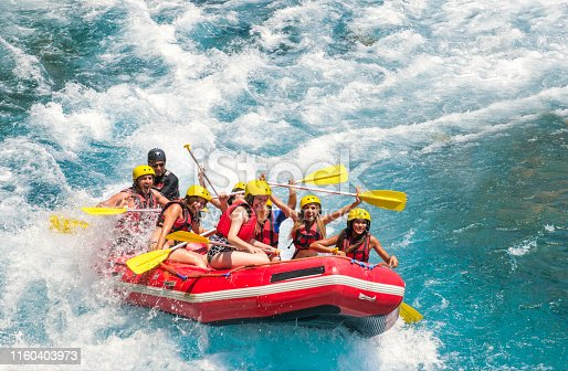 istock Group of people white water rafting 1160403973