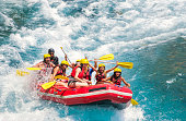 Group of people white water rafting