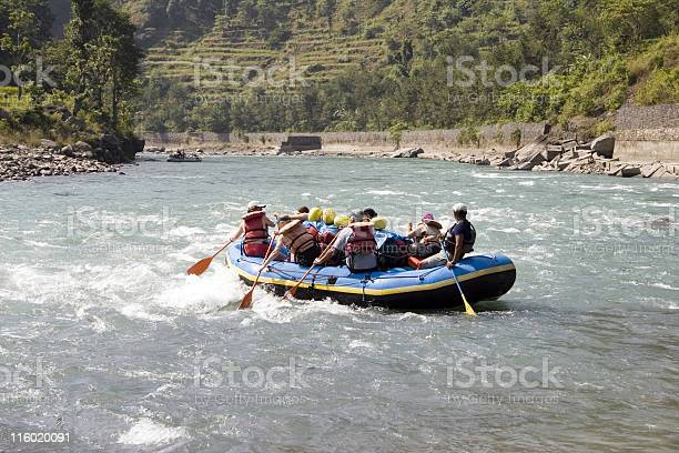 Group of people whitewater rafting in Nepal