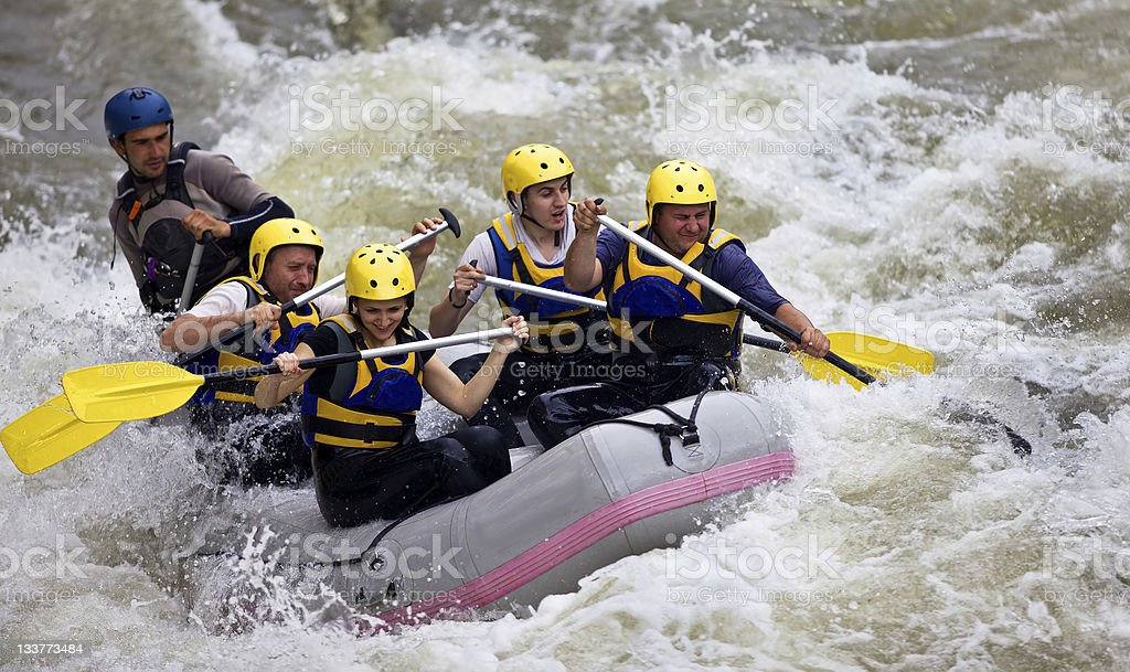 Group of people whitewater rafting stock photo