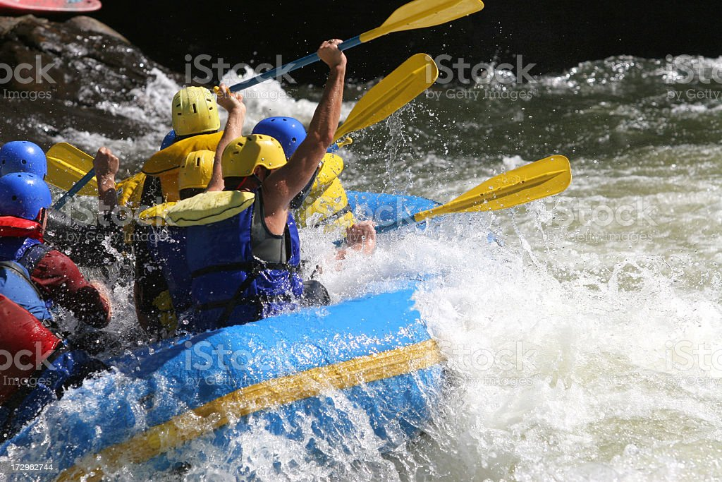 A group of people whitewater rafting stock photo