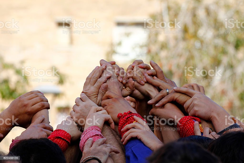 Group of people with hands up together stock photo