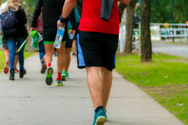 Group of people with sportswear walk doing exercise stock photo