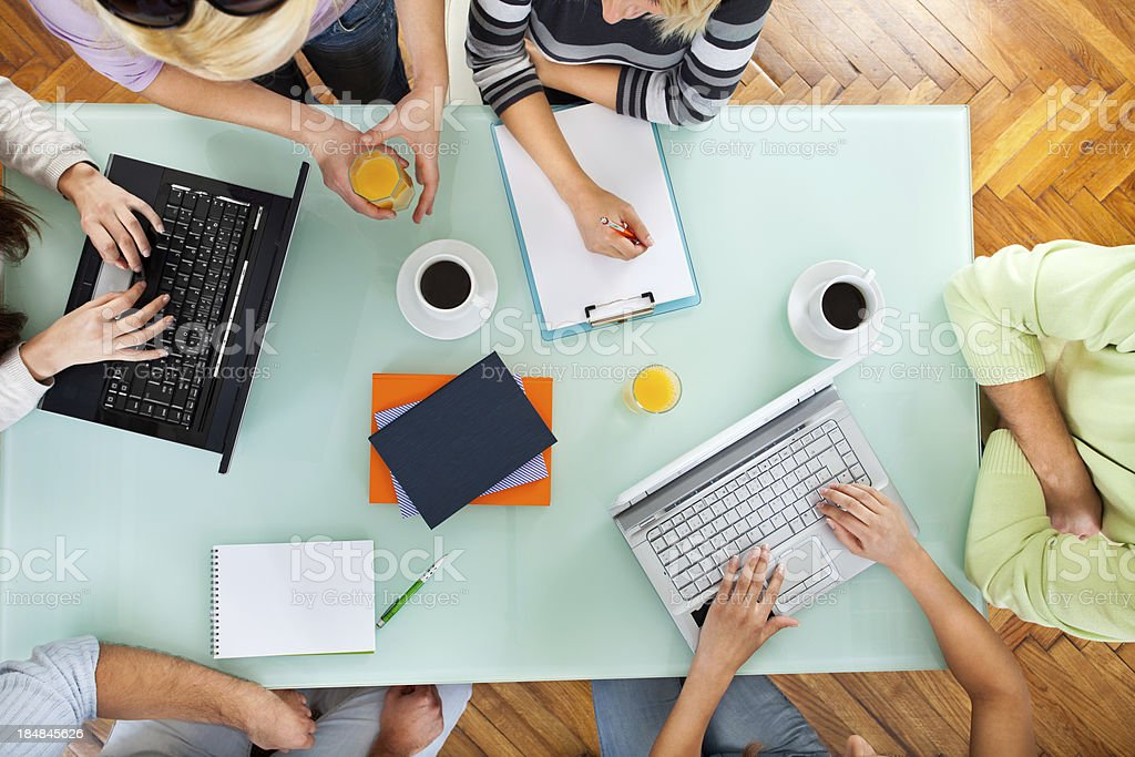 Group of people with two laptops at a meeting stock photo