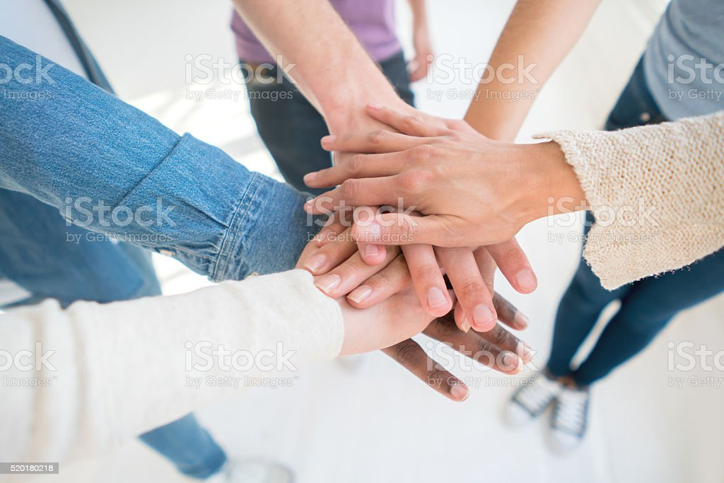 Group of people working at a team stock photo