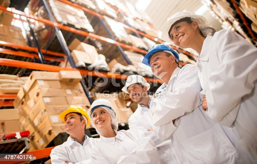 istock Group of people working at a warehouse 478740174