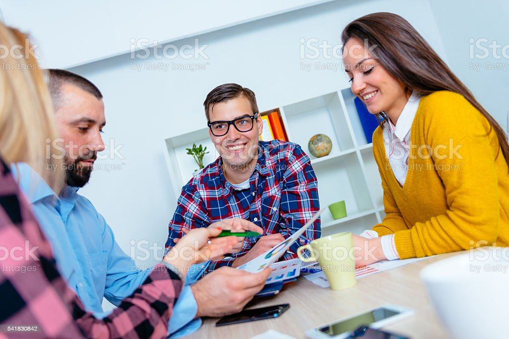 Group of people working in team and brainstorming over start-ups stock photo