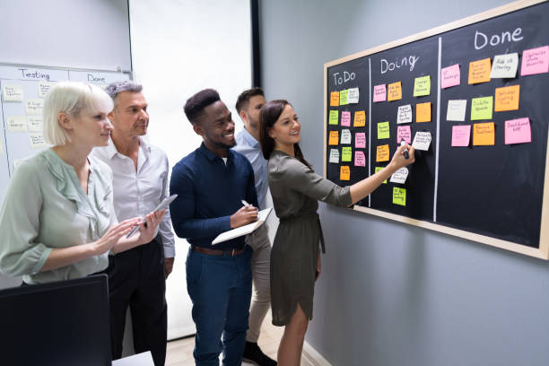 Group Of People Writing On Sticky Notes stock photo