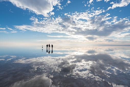 Group of Photographer  having fun  on salt lake at sunset