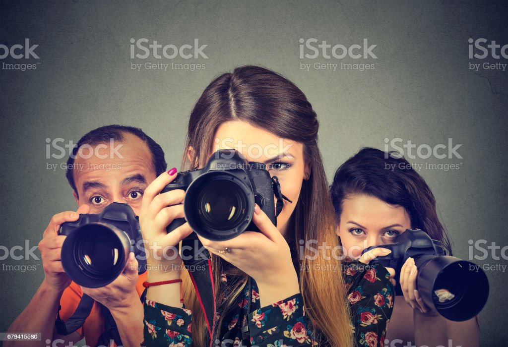 Group of photographers with professional cameras stock photo