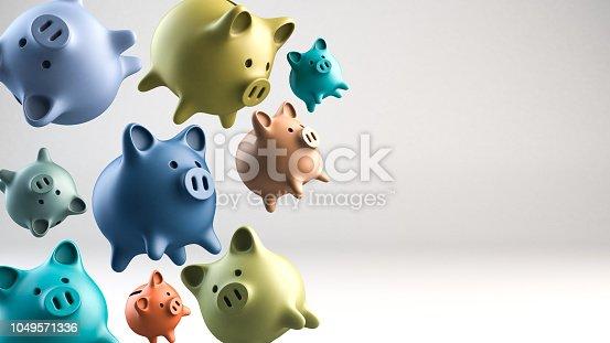 Group of piggybanks flying on white background. Studio shot