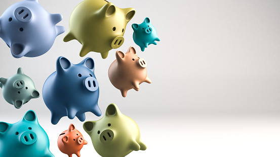 Group of piggybanks flying on white background. Studio shot