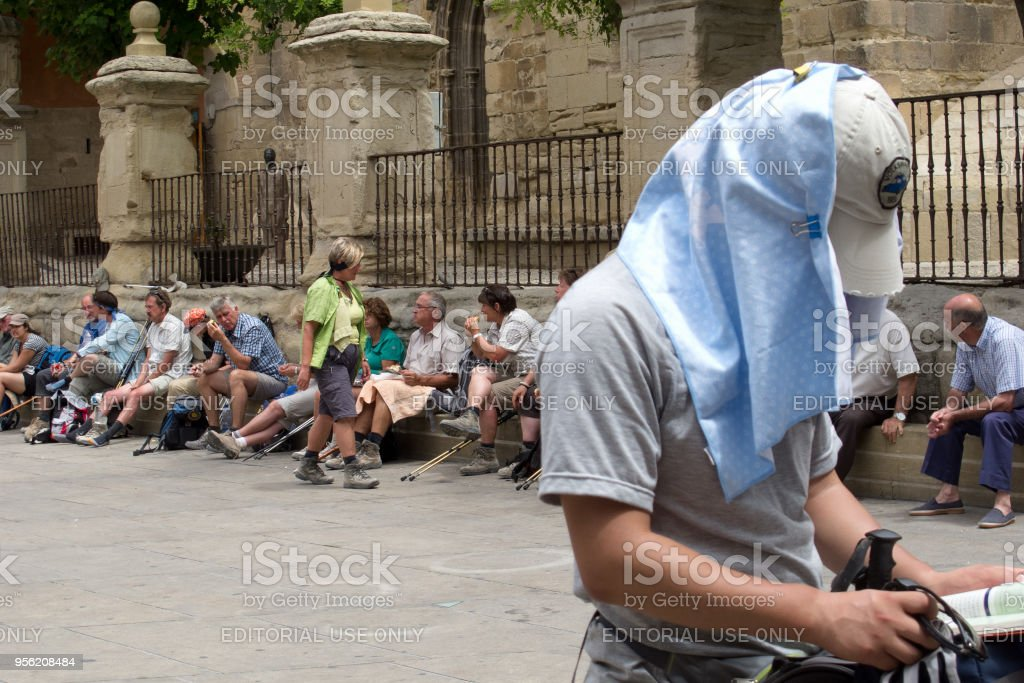 A group of pilgrims stops for a rest, on the french Way of St James (Camino de Santiago), to Compostela stock photo