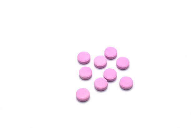 group of pink pills isolated on white background. - amfetamin pills bildbanksfoton och bilder