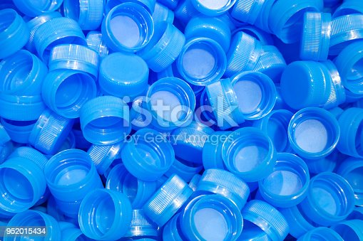 istock group of plastic bottle caps are ready to send to production line in drinking water factory. 952015434