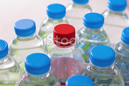 Closeup rows and pack of Plastic water bottles.