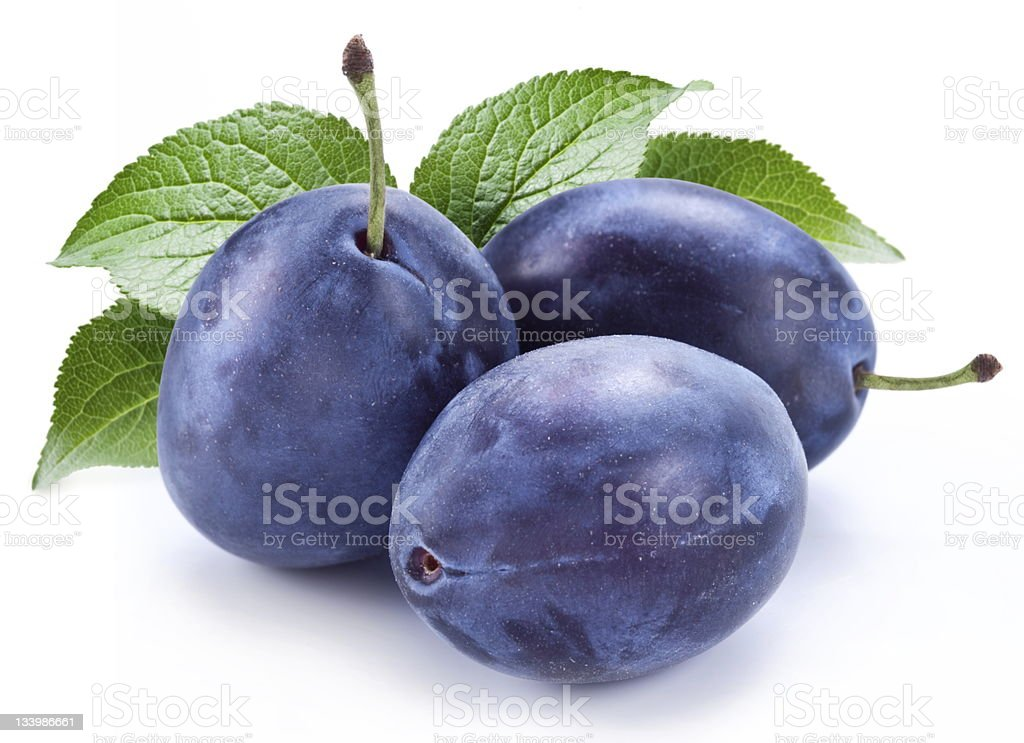 Group of plums with leaf. stock photo