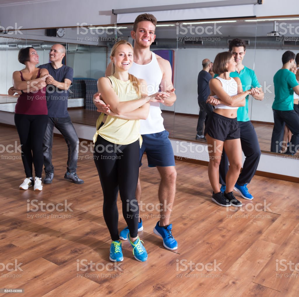 Group of positive adults dancing bachata together stock photo