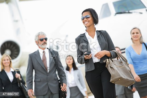 istock Group of powerful business executives deboarding private company jet 471660737