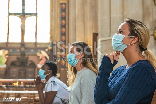 istock Group of prayers in Covid times 1255371838