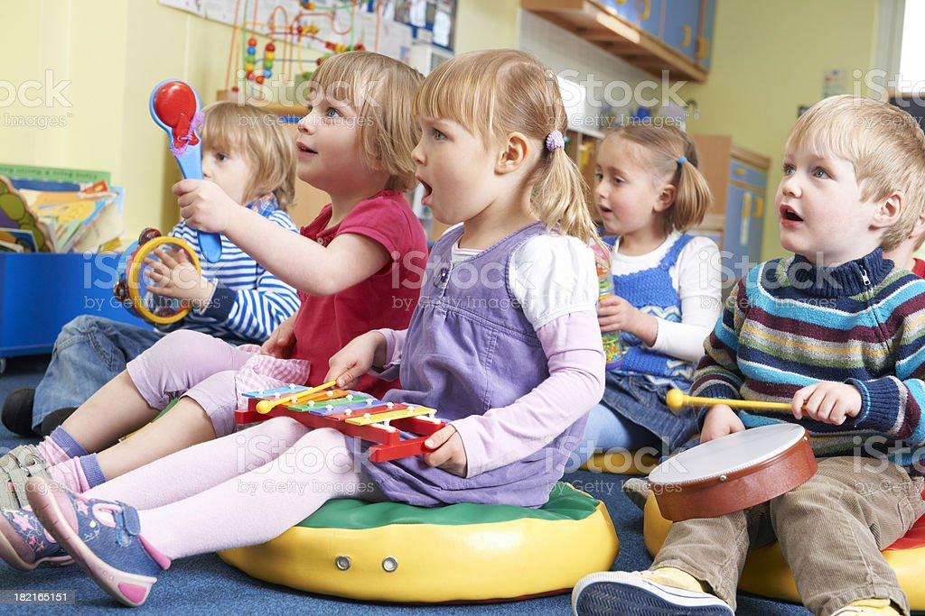Group Of Pre School Children Taking Part In Music Lesson royalty-free stock photo