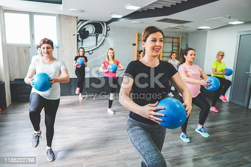 Group of pregnant women training yoga, pilates and fitness with instructor