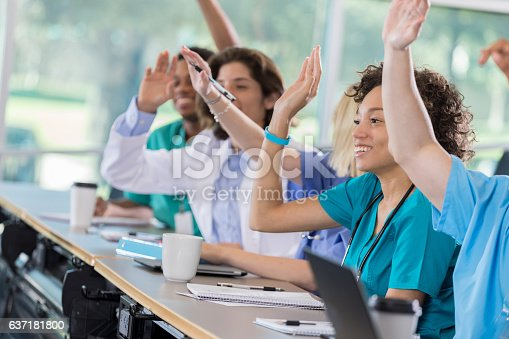 istock Group of pre-med students raise hands in class 637181800