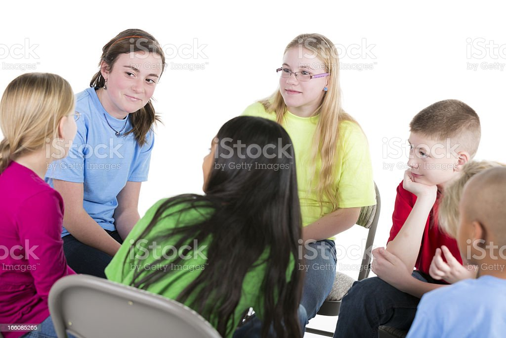 Group of pre-teens children talking in a circle royalty-free stock photo