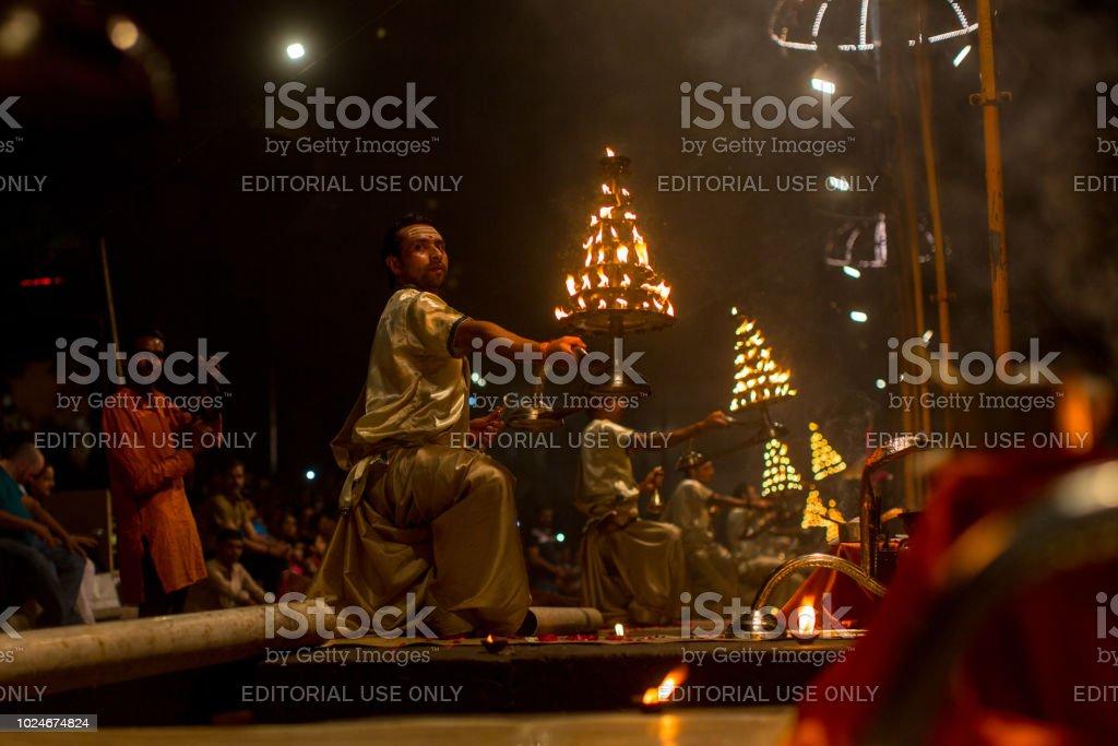 A group of priests perform Agni Pooja in Varanasi. stock photo