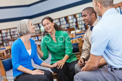 956725746 istock photo Group of professional adults enjoying meeting together 171336541