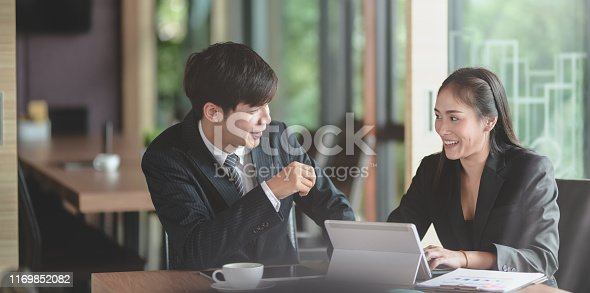 1068752548istockphoto Group of professional business people discussing the project together 1169852082