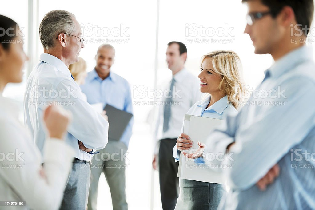 Group of professional businessmen and women talk stock photo
