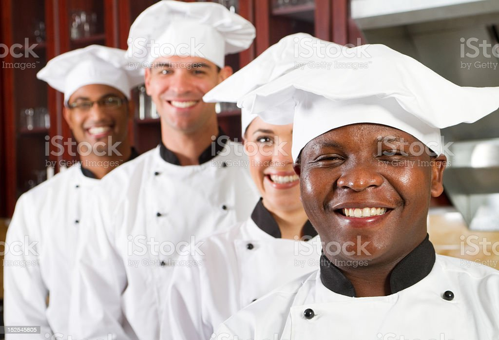 group of professional chefs in kitchen stock photo