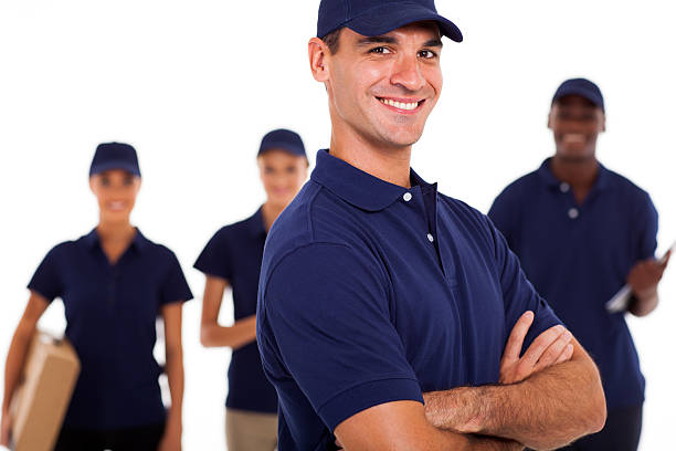 group of professional it technicians - uniform stock photos and pictures