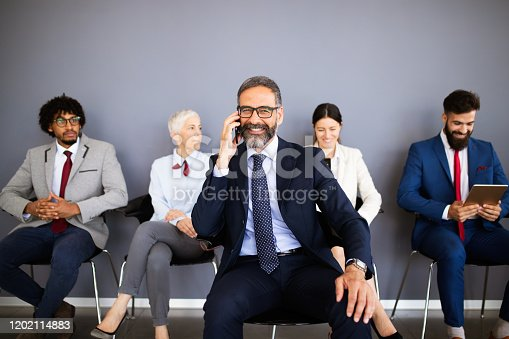 669854210 istock photo Group of proffesional business people communicating in modern office 1202114883
