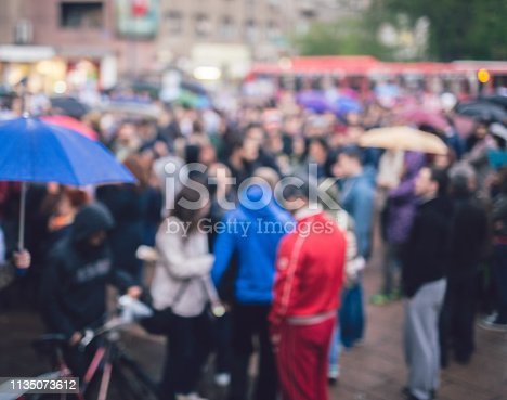 istock Group of Protesters Abstract Out Of Focus Background 1135073612