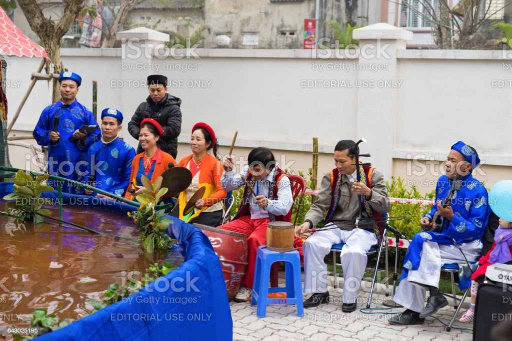 Hanoi, Vietnam - Feb 7, 2015: Group of puppetreers perform a puppetry show at Vietnamese lunar new year festival organized at Vinschool, Vinhomes Times City, Minh Khai stock photo