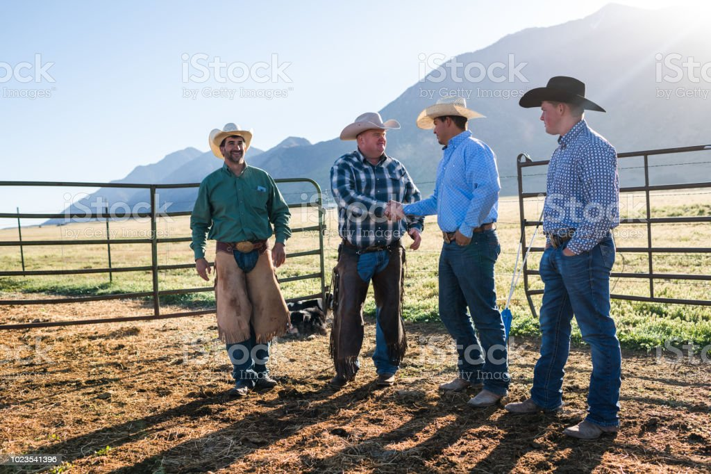 Group of ranchers standing together and greeting each other stock photo