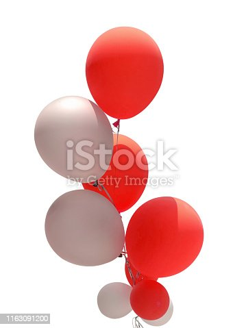 istock Group of red and white balloons 1163091200