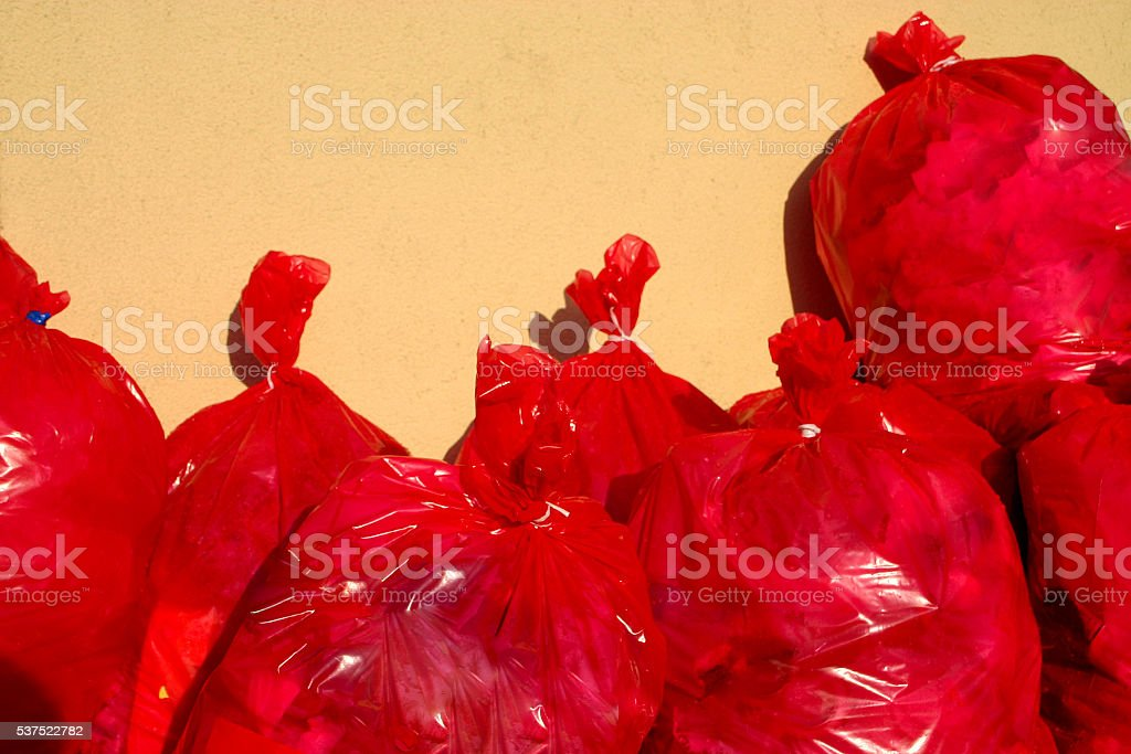 Group of Red Garbage Bags stock photo